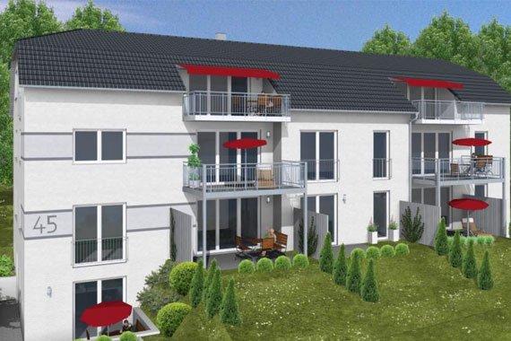 Aussenansicht eines Mehrfamilienhauses mit großzügigen Balkonen und Grünanlage
